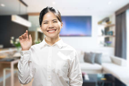 Asian female real estate agent greeting with warm welcome