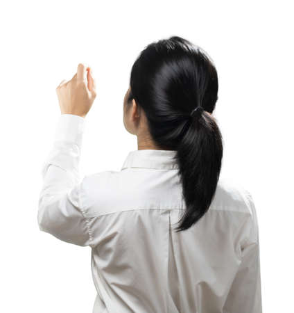 Asian woman finger point wear white shirt rear view isolated on white background
