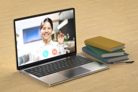 Online conference or video call with asian woman on computer notebook
