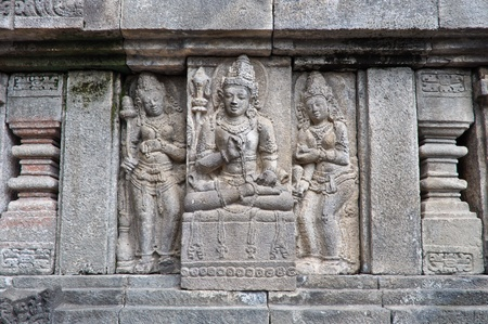 Carved stone on the old buddhist temple, Jogjakarta, Indonesia photo