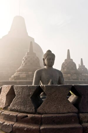 jogjakarta: Stoned image of Buddha in Borobudur, Indonesia Stock Photo