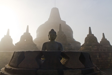 stoned: Stoned image of Buddha in Borobudur, Indonesia Stock Photo