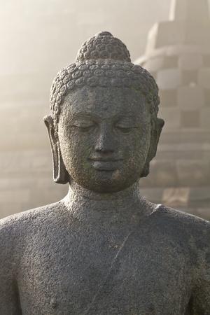 buddha image: Stoned image of Buddha in Borobudur, Indonesia Stock Photo