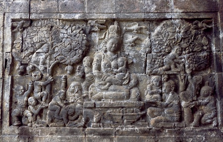 Carved stone at Borobudur on Java, Indonesia photo
