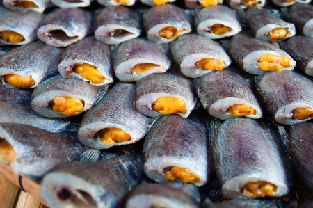 spawn: Dried fish with spawn in market Stock Photo