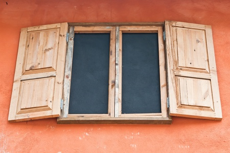 Wooden window box on wall Italian style photo