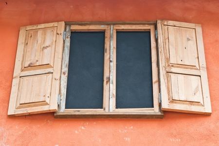 Wooden window box on wall Italian style photo