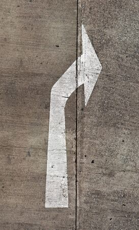 The arrow on the road. Old and chipping paint Stock Photo - 13627985