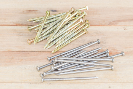 construction nails: Construction nails lubrication for long-term storage to pour out on the table.