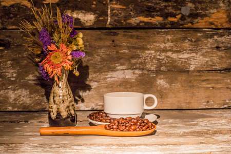 Coffee cup and vases on wooden background photo