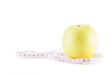 centimetre: Pear and measuring tape isolated on white background Stock Photo
