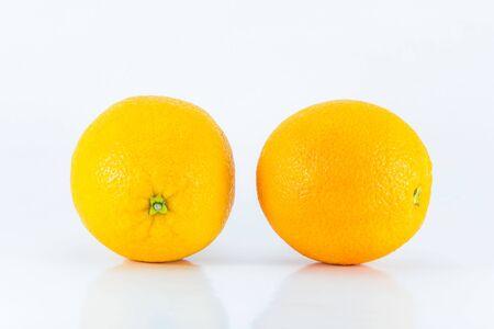 sweet segments: Orange fruit isolated on white Stock Photo