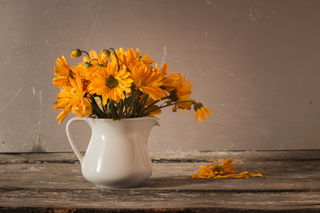 autumn arrangement: still life vase with flowers background
