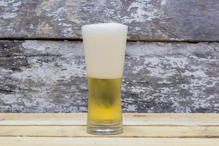 un bottled: beer on wooden background