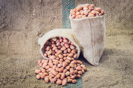 monkey nuts: fresh ground nuts on sackcloth Stock Photo
