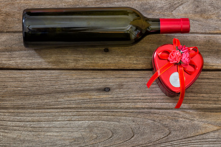 twist cap: wine bottle and corkscrew on a paper background Stock Photo