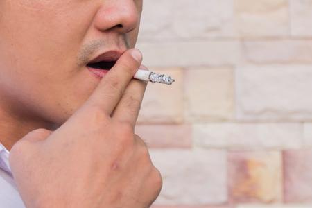 drug control: a young man smoking a cigarette Stock Photo