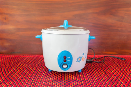 vintage style rice cooker electric pot on table.