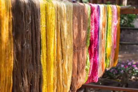 Colorful silk made of natural protein fiber, some forms of which can be woven into textiles. Foto de archivo