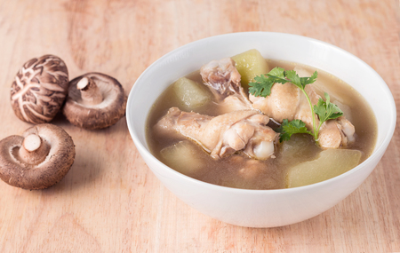 Chicken soup, chicken soup in a cup on wooden background.