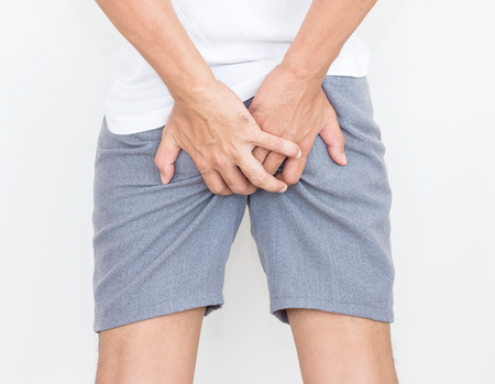 Young man has pain in the butt, Hemorrhoids, Anal disorders. Banco de Imagens - 103008286