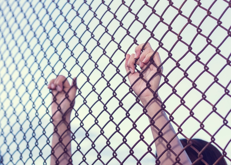 Young woman hold cage with sad and hopeless Banco de Imagens