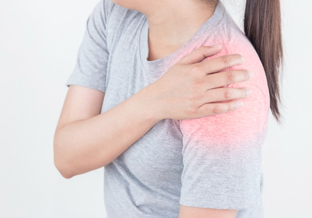 Young woman suffering from pain the shoulder, Health Care Concept. Banco de Imagens