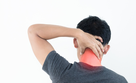 Young man feeling exhausted and suffering from neck pain, Health concept. Banco de Imagens - 110615630