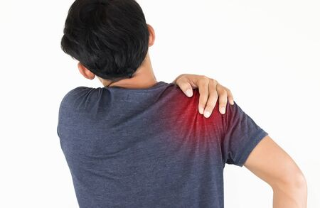 Young man suffering from pain the shoulder, Health Care Concept. Banco de Imagens - 134364868