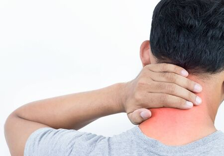 Young man feeling exhausted and suffering from neck pain, Health concept.
