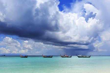 beach rain: Beautiful tropical beach with cumulus storm cloud and pouring rain at Lipe, Thailand