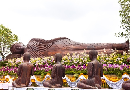 reclining buddha and his disciple photo