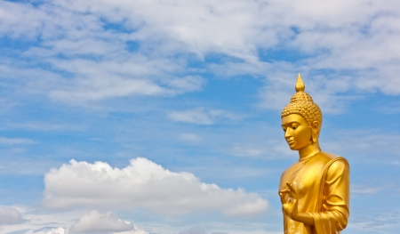 golden religious symbols: buddha image with beauty sky