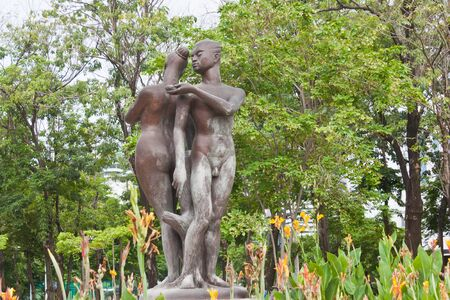man and woman statue in garden