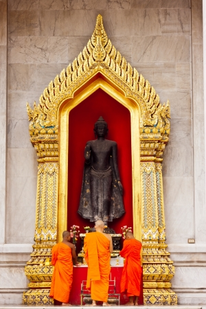 Buddha statue at Wat Benchamaborphit in thailand photo