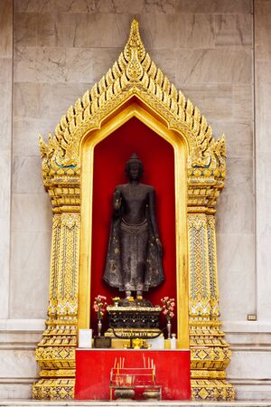 Buddha statue at Wat Benchamaborphit in thailand photo
