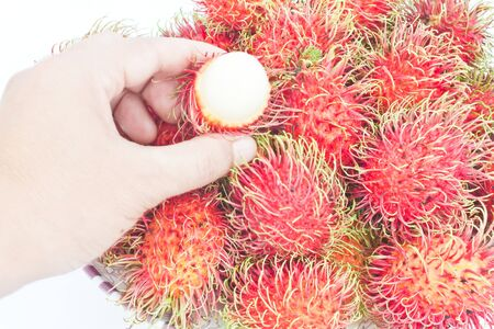 Many appetizing rambutans from fram of Thailand photo