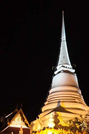 pagoda at night time in Thailand photo