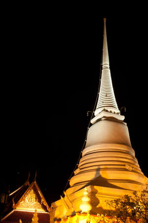 pagoda at night time in Thailand Stock Photo