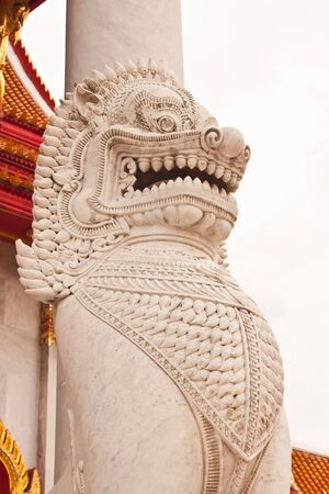 The lion image in front of Buddhist church at wat benchamaborphit in Thailand photo
