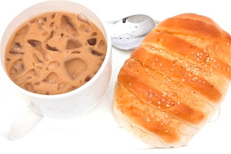 Appetizing bread and cup of ice tea on white paper