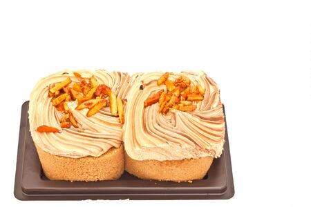 Almond cake on white paper photo