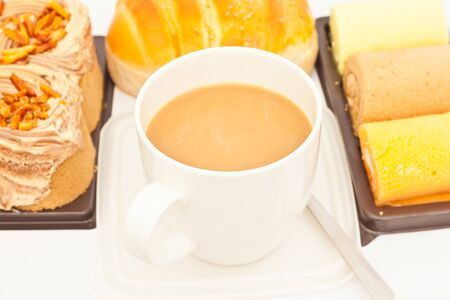 Delicious breads and cup of coffee on white paper Stock Photo - 14869970