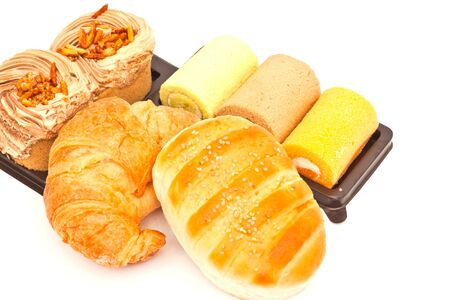 Delicious breads on white paper photo