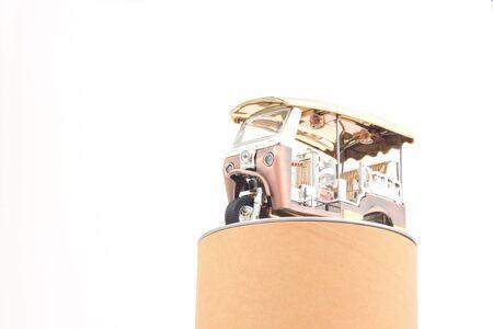 three wheeler: golden tuk tuk car with circle box