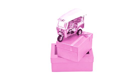 pink tuk tuk on box photo