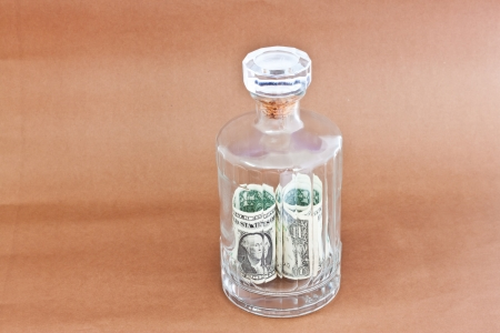 dollars in bottle photo