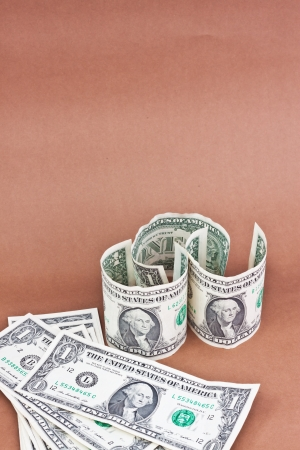 many dollars on brown background Stock Photo - 16502861