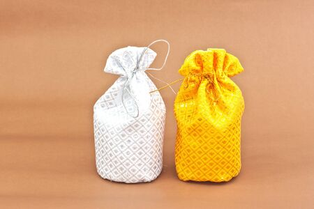 two money bag on brown background Stock Photo - 16479434