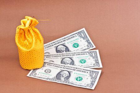 golden money bag with dollars Stock Photo - 16479473